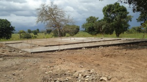 The R.A.U. Guesthouse foundation is complete. Please pray for its completion!