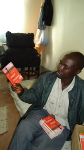 Congolese Pastor receiving John Piper books in French