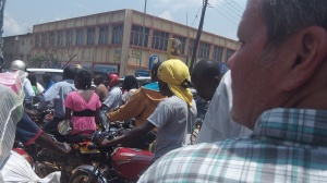 Traveling downtown Kampala by motorcycle taxi (Boda-boda)