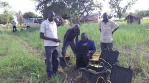 Here the computer is reading electrical charges using a generator to locate the best pools of water and their depth. Please note that this is being done in the African bush :-).
