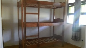 Our first triple bunk bed is in place. All it needs now are its mattresses and mosquito nets.