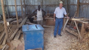This is the shop in Moyo which has been milling our lumber. Their saw is run by a generator.
