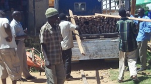 Loading lumber in Moyo town for the roof.