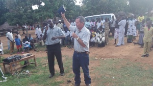 Evangelistic preaching in an outdoor market with Pastor Abraham