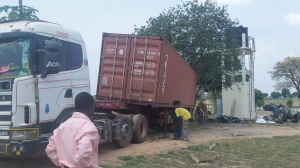 """The container """"almost"""" tipped on it's side several times in its slide off the the trailer."""