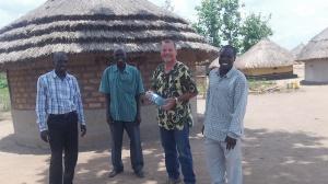 Taking a break with Pastor Bosco, Michael, and Pastor Godfrey