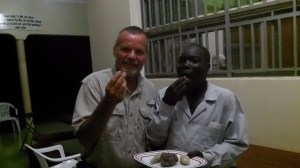 Godfrey and I enjoying a late night snack of sweet potatoes and white ants (termites). The white ants are delicious!