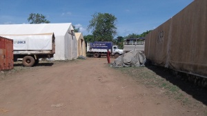 When we arrived at the  UNHCR the cassava was loaded on the truck to the left