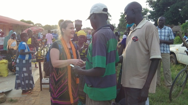 Carol sharing the gospel in a rural Yumbe District market