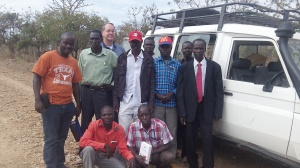 Nurse Sam (in the Texas shirt) and Paul with the Gbari/Arapi outreach team