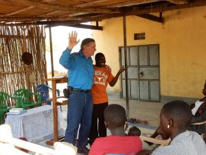 John preaching with Godfrey interpreting