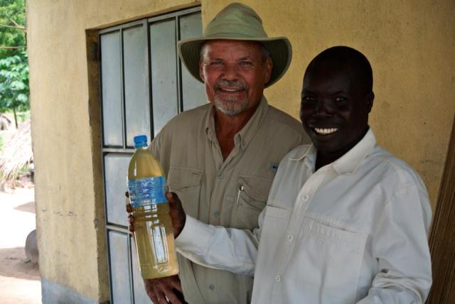 Godfrey and Obongi drinking water