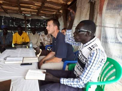 Pastor Edward with Pastor Tobious who interpreted in a session at Gbari/Arapi Community Church.
